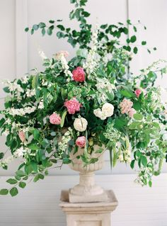 I like the greenery and the flowers (just a bit too pink).  Also not this style urn.