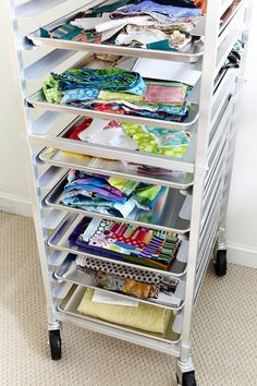 "Baker's Rack ""Roll-around commercial baker's rack (aka bun rack) holds projects under construction. Limit it to one project per tray. Each tray (a full-size commercial cookie pan/tray) contains everything needed to complete a single project. This rack holds 20 trays. That's a lot of UFOs.""  --Jill Mead, editor"