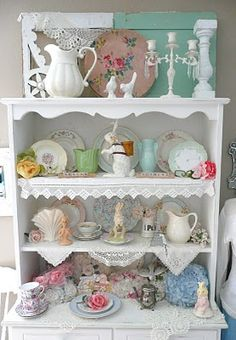 Colorful plates and glassware can make a boring white shelf look shabby chic instantly!