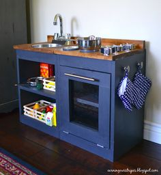 DIY Play Kitchen From Earning Our Stripes ---- love her blog!! Love dark blue with wood countertop