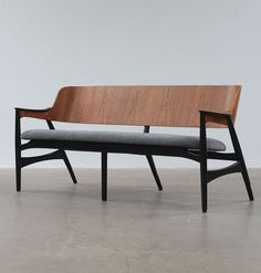 Anonymous; Molded Teak and Ebonized Wood Bench, c1950.
