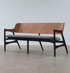 Anonymous; Molded Teak and Ebonized Wood Bench, c1950.