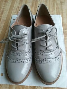 Color: Grey Style: Franco Sarto Glossy Oxfords Size: 5M  Condition: Seldom Used I'm selling them for the firm price as listed. If you are intersted you could message me on here and i will not give out my personal information to anyone meaning, email, phone number, address, full name, etc. Please let  me know the day and time you'd like to purchase the shoes and have cash.  *Please note: I don not accept checks.