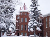 Built in 1894, Old Main is the oldest building on the Northern Arizona University campus. Once home to classrooms, offices and a men's dormitory, the Romanesque-style Old Main now houses an art gallery, museum and offices, including Alumni Relations.