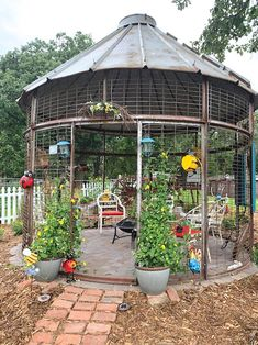 """""""My wife Colette comes up with a lot of unusual ways to use old farm equipment, but her latest one about tops the list,"""" says Lance Seltun. """"Last summer we saw an old wire ear corn crib on a drive in ... Backyard Projects, Outdoor Projects, Garden Projects, Backyard Gazebo, Backyard Retreat, Patio Grill, Ranch Decor, Pergola With Roof, Outside Living"""
