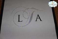 An initial fully encrusted with sparkling crystals for a wedding aisle runner #blingaislerunners, #springweddingrunners