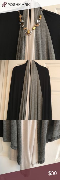 BLACK GREY & WARM IVORY LONG CARDIGAN This cardigan has such a beautiful flow to it.. jet black, dark heather grey and Ivory make it exceptionally pretty. Pre-loved in great condition. The necklace is not included. Forever 21 Sweaters
