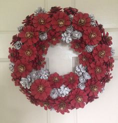 A personal favourite from my Etsy shop https://www.etsy.com/uk/listing/568169945/christmas-wreath-pinecone-wreath-red