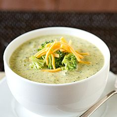 Broccoli Cheese Soup  INGREDIENTS:  ½ cup unsalted butter  1 yellow onion, finely chopped  1/3 cup all-purpose flour  4 cups whole milk  2 cups half-and-half(fat free)  4 heads broccoli, stems removed and discarded, and florets cut into bite-size pieces  Pinch of nutmeg  12 ounces mild cheddar cheese, shredded (about 3 cups)  Salt and pepper  2 cups vegetable broth