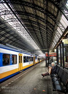 Amsterdam Central Station. Can buy return ticket, from Schiphol airport, online: https://www.nsinternational.nl/web/Intercity-direct-3/Airport-City-Centre-Train.htm?utm_medium=affiliate&utm_campaign=tradetracker&utm_source=affiliateid-83618