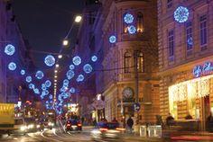 """Wirtschaftskammer Wien - LightUp - Element Design  Light up! Weihnachtsbeleuchtung für Wien, ein Projekt der Wirtschaftskammer Wien. """"Magische Kugeln"""" ziehen sich durch die komplette Josefstädterstrasse. Die ganze Einkaufsstrasse glitzert in blau und der Besuch wird zum Erlebnis. Trotz der grossen Herausforderung, eine sehr schmale und fast zwei Kilometer lange Strasse zu beleuchten, ist eine aufsehenerregende Lichtinstallation gelungen, über die man spricht."""