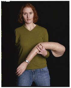 Dawn Halfaker, a West Point graduate, holding the prosthesis for her missing right arm: