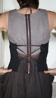 this is cute, looks fairly easy.  In bias and a stiff fabric might not need boning even with a short waist. ???
