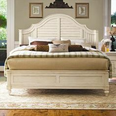 """Wood bed with a louvered headboard and raised bead molding.   Product: BedConstruction Material: WoodColor: LinenFeatures: Part of the Paula Deen Home CollectionLouvered headboardDimensions: Queen: 64"""" H x 69"""" W x 86"""" DKing: 68"""" H x 85"""" W x 84"""" D"""