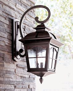 """Colonial"" Three-Light Wall Lantern at Horchow. These are lovely and would look great throughout the seasons. But imagine how Christmas classic they would be during the holidays! Porch Light Fixtures, Exterior Light Fixtures, Farmhouse Light Fixtures, Kitchen Lighting Fixtures, Exterior Lighting, Front Door Lighting, Garage Lighting, Outdoor Wall Lighting, Lighting Ideas"