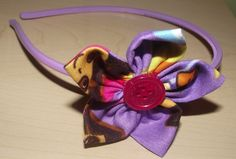 Dora fabric flower attached to headband~ $5