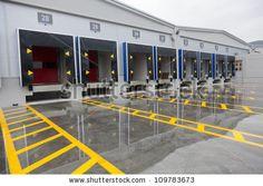 Loading dock cargo doors at big warehouse by Portokalis, via Shutterstock