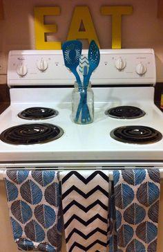 Nicholl Vincent: A DIY Home Tour- cute kitchen & stove arrangement
