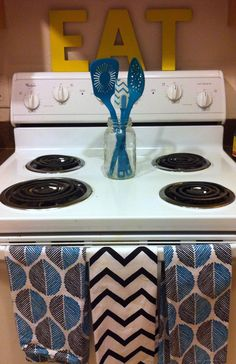 I like the three towel part! Nicholl Vincent: A DIY Home Tour- cute kitchen stove arrangement