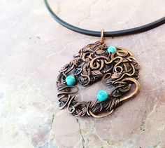 Metalwork Jewelry  Handmade antique oxidized copper pendant The Magic of Present has been wire wrapped, polished and decorated with turquoise beads. This unique woven fairytale charm ir perfect gift for her.  Time is only an aroma in silence, The golden grains flow in space. Each rustle is a reminder of itself, Each rustle is a reminder of your movement. The size of the pendant - 6 х 5cm (2,3 x 2 inches).  Please contact me if you have any questions about my jewelry! Many thanks and happy…