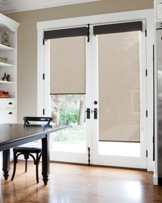 Solar Roller Shades in 13221 Link/ Wheat Layered with Tailored Upholstered Cornice in 13789 Trump/ Charcoal