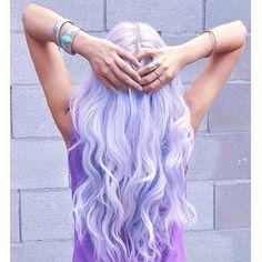 Light curls long pastel dyed hair. Lilac purple color. Colour.