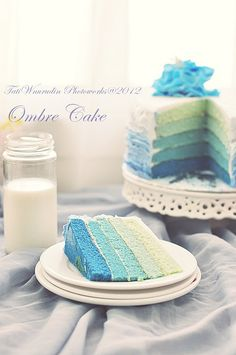 A rainbow cake is fun to look at and eat and a lot easier to make than you might think. Here's a step-by-step guide for how to make a rainbow birthday cake. Pretty Cakes, Beautiful Cakes, Amazing Cakes, Cupcakes, Cupcake Cakes, Torte Frozen, Torta Angel, Ombre Cake, Blue Cakes