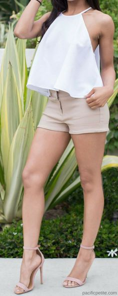 Women's khaki shorts, with white tank top and kate spade cross body purse quay quay sunglasses by desi perkins. perfect outfit for spring, summer. casual, chic, classy and trendy