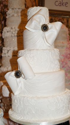 Pretty Bows & Elegant design! Captured at the 2014 Wedluxe Show by MMDC!   Cheers