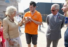 Camilla Parker Bowles Photos - Camilla, Duchess of Cornwall and Prince Charles, Prince of Wales are shown a piglet as they visit Humble by Nature Farm on July 9 2015 in Monmouth, Wales. Humble by Nature is a working farm which was saved from closure by Kate Humble and her husband Ludo Graham in 2010. It includes a rural skills centre as well as a farm shop, cafe and adventure playground. - The Prince of Wales & Duchess of Cornwall Visit Wales - Day 4