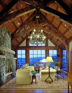 Timber frame great room with stone fireplace (Resort Design Architects)