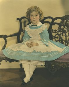 Shirley Temple in costume featured in the 1935 film, The Littlest Rebel. Costumes, photographs, dolls and more to be featured in countrywide exhibits before being auctioned by Theriault's on June 14, 2015. https://www.theriaults.com/love-shirley-temple-events-auction-schedule