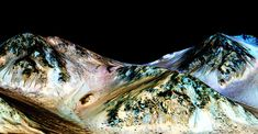 Scientists say they've found evidence of flowing water on Mars. Salty brines found in dark streaks that show up and disappear throughout the Martian year are evidence that briny water is flowing on the Red Planet, scientists say.