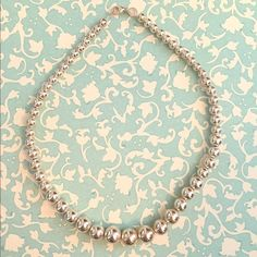 Tiffany & Co. Silver Bead 10mm Ball Necklace This necklace has been worn only a few times. Get it polished at a local jewelry store and otherwise in excellent condition!! 16.25 inches long. A classic piece for your jewelry collection! Tiffany & Co. Jewelry Necklaces