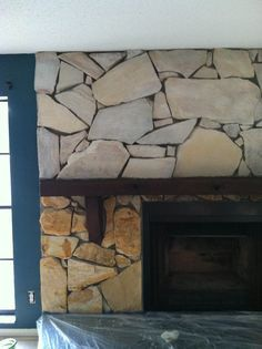 this is a great before and after pic representing how whitewashing stone can give a dark home a much lighter feel.