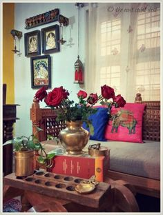 Indian decor elements - vintage brass, hanging diyas, carved wooden panels, Tanjore paintings, ornate furniture, punches of color (The home of Bhuvana Sharma)