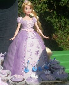 Rapunzel barbie doll cake with cupcakes
