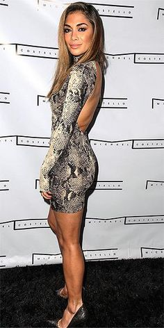 Our favorite Pussycat Doll Nicole Scherzinger is sultry in this snakeprint dress.