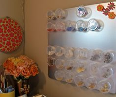 Storage Solution Roundup: Beads magnetically attached to metal board.