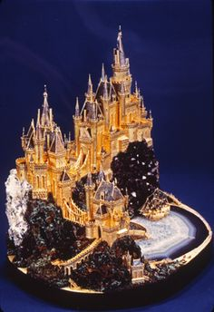 Castle Lizzadro by Willliam Tolliday (18k gold, faceted diamonds, Brazilian agate slab, amethyst, malachite, azurite, and vanadium specimens)