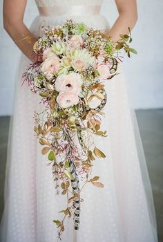 cascading spring wedding bouquet idea by green goddess flower studio |  lauren kriedemann photography
