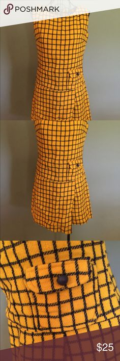 "Vintage 1970's Plaid Romper This adorable romper is a unique piece of 1970's clothing. I love the beautiful mustard yellow and navy color combination. It has one decorative pocket and a metal zippered back.   Please read the measurements to ensure a proper fit.   Bust - 32-34"" Waist - 28-30"" Inseam - 4.5"" Vintage Shorts"