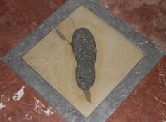 Devil's Footprint at the entrance of Frauenkirche Munich Germany. The legend says the devil was so angry about the church being erected that he tried to get inside and destroy it. But he couldn't and left only his footprint as a warning.