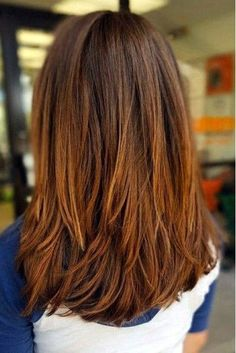 Thick Long Layers - If you have thick hair, longer layers like these look really great on a mid-length cut. The layers meld cohesively without being choppy or stacked.
