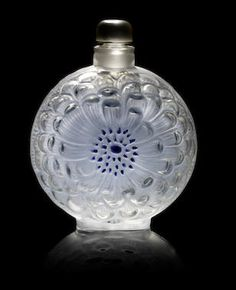 ... René Lalique 'Dahlia' a Perfume Bottle and Stopper, design 1931 frosted glass, with blue enamel ... staining; together with an 'Ambre Antique' perfume bottle, design 1910, frosted and heightened.