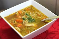 Asian Chicken Noodle Soup - A kick of ginger gives it an exotic flair and makes this an awesome soup to eat when you are sick!