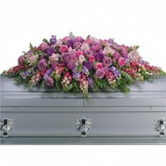 Lavender Tribute Casket Spray flower arrangement #casket #flowers Walker Funeral Home Cincinnati, OH www.herbwalker.com