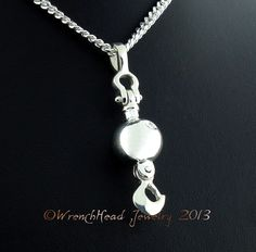"""This Pendant is based on the Ball and Hook assembly commonly found on Cranes. Also known as a Headache Ball. If you're an Ironworker or Crane Operator you would be at home with this. It is articulate and moves both at the top and from the hook. The ball is solid, not hollow. The Pendant is cast in Argentium Sterling Silver which is one of the finest Alloys available. This exceptional metal exhibits a fine white color and has anti tarnish qualities. It's approximately 1 3/4""""..."""