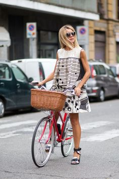 Natalie Joos in Antonio Marras dress and shoes while riding a Tokyobike bike.