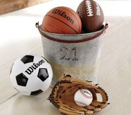 Metal pail with small sports balls. ideas for vintage sports theme bedroom.